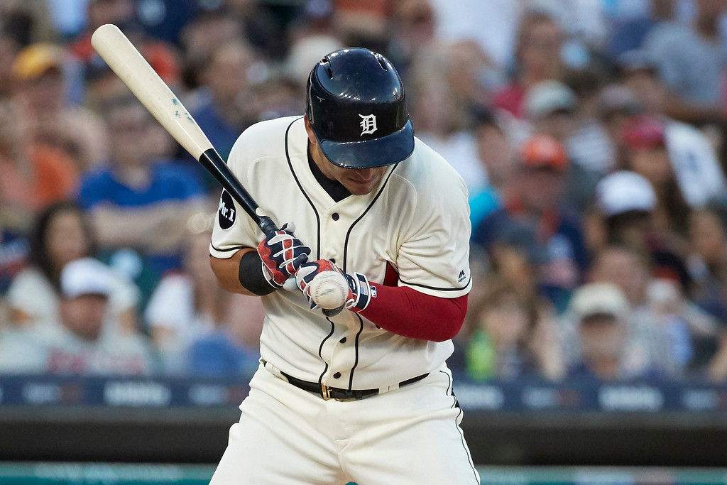 . Detroit Tiger Jose Iglesias is hit by a pitch during the fourth inning against the Cleveland Indians in the second baseball game of a doubleheader in Detroit, Saturday, July 1, 2017. (AP Photo/Rick Osentoski)