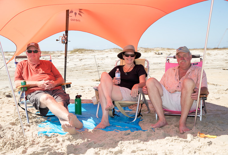 Paul mom and dad under beach tent.jpg