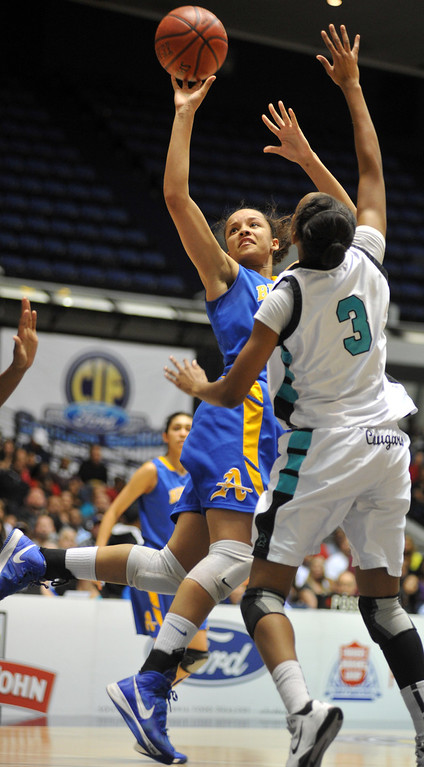 . Bishop Amat\'s Mauriana Clayton (#23) turns to make a shot as they play Canyon Springs in the CIF-SS Division 1A girls basketball finals at the Anaheim Arena on Friday February 28, 2013. Canyon Springs beat Bishop Amat 48-46. (SGVN/Staff Photo by Keith Durflinger)
