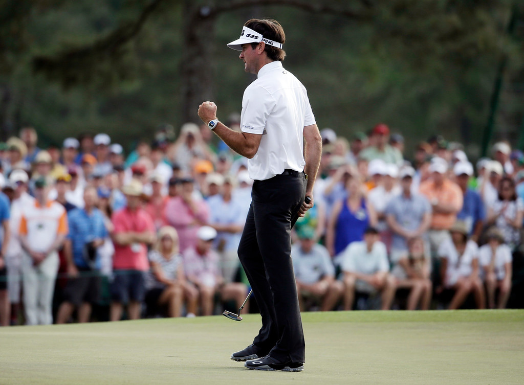 . Bubba Watson punches the air on the 17th green during the fourth round of the Masters golf tournament Sunday, April 13, 2014, in Augusta, Ga. Watson went on to win the Masters championship. (AP Photo/Darron Cummings)