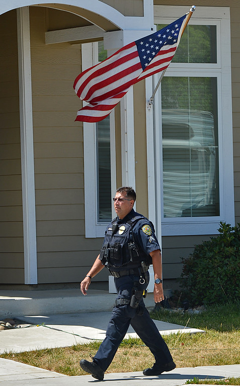 . A Brentwood police officer guards the home of  Sgt. Scott Lunger, of the Hayward Police Department, who was shot and killed early Wednesday morning in Hayward after making a traffic stop on a driver who was driving erratically, in Brentwood, Calif., on Wednesday, July 22, 2015. (Dan Rosenstrauch/Bay Area News Group)