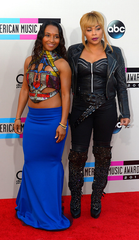 . T-Boz (R) and Chili of TLC arrives to the American Music Awards  at the Nokia Theatre in Los Angeles, California on Sunday November 24, 2013 (Photo by Andy Holzman / Los Angeles Daily News)