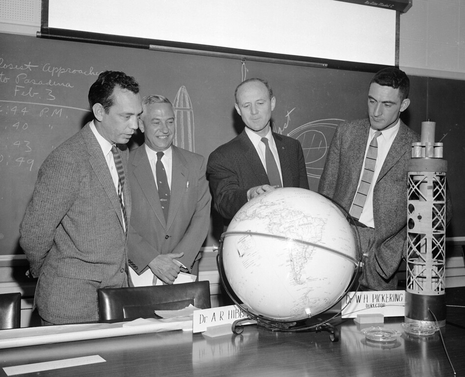 . Dr. William H. Pickering, director of Cal Tech\'s Jet Propulsion lab, second from right, points to a globe at a news conference in Pasadena, Calif., Feb. 3, 1958.  At right is a model of the satellite.  From left to right: Dr. I.E. Froelich, project engineer; Dr. Lee DuBridge, Cal Tech president; Pickering; and Dr. A.R. Hibbs of Cal Tech.  (AP Photo)