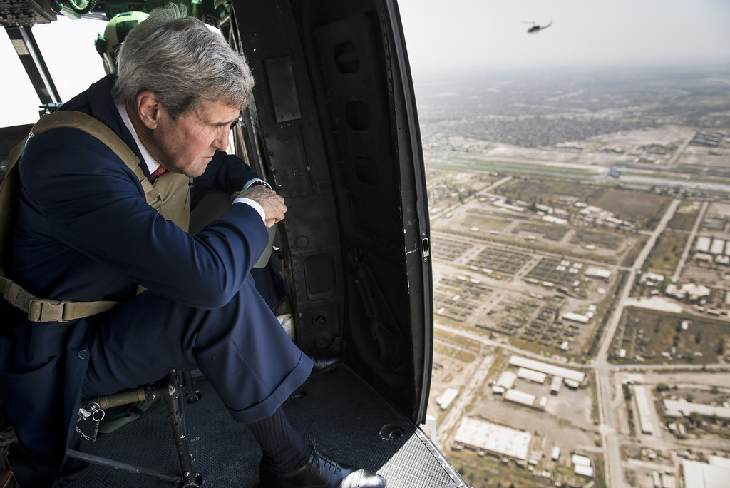 . US Secretary of State John Kerry looks out over Baghdad  from a helicopter on September 10, 2014. Kerry flew into Iraq today for talks with its new leaders on their role in a long-awaited new strategy against Islamic State jihadists to be unveiled by President Barack Obama. AFP PHOTO/POOL/BRENDAN SMIALOWSKIBRENDAN SMIALOWSKI/AFP/Getty Images