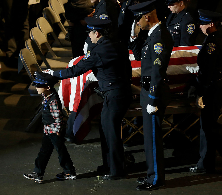 ". Joaquin Wu, 5, leads his mother\'s casket, containing Santa Cruz Detective Elizabeth Butler, following a memorial service Thursday, March 7, 2013, at HP Pavilion  in San Jose, Calif. Butler and Santa Cruz police Sgt. Loran ""Butch\"" Baker were shot to death on Feb. 26, after arriving at the home of Jeremy Peter Goulet to question him about a misdemeanor sexual assault. (AP Photo/Ben Margot)"