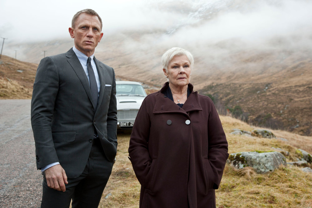". This film image released by Sony Pictures shows Daniel Craig as James Bond, left, and Judi Dench as MI6 head M, in a scene from the film ""Skyfall.\"" Dench has been the Bond matriarch: the strong-willed, no-nonsense mainstay of feminine authority in a movie franchise that has, more often than not, featured slightly more superficial womanly traits. In \""Skyfall,\"" Dench isn\'t just dictating orders from headquarters, but is thrown directly into the action when a former MI6 agent, played by Javier Bardem, is bent on revenge against her.   (AP Photo/Sony Pictures, Francois Duhamel)"