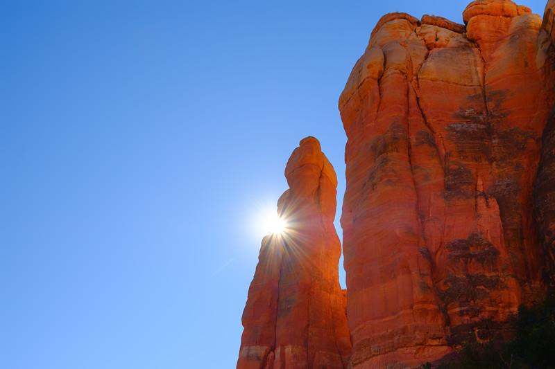Sun peeking around part of Cathedral Rock