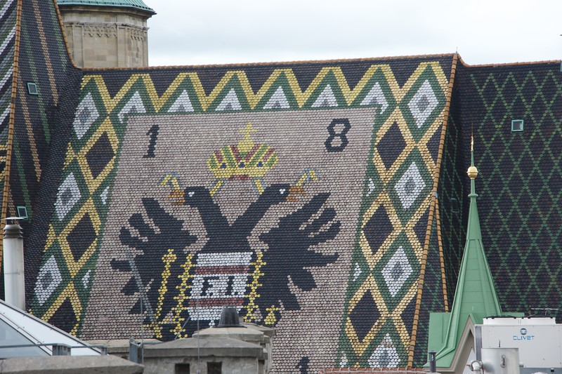 The roof is decorated with some 230,000 glazed tiles. The tiles form a mosaic of the double-headed eagle, a symbol of the empire ruled from Vienna by the Habsburg dynasty.