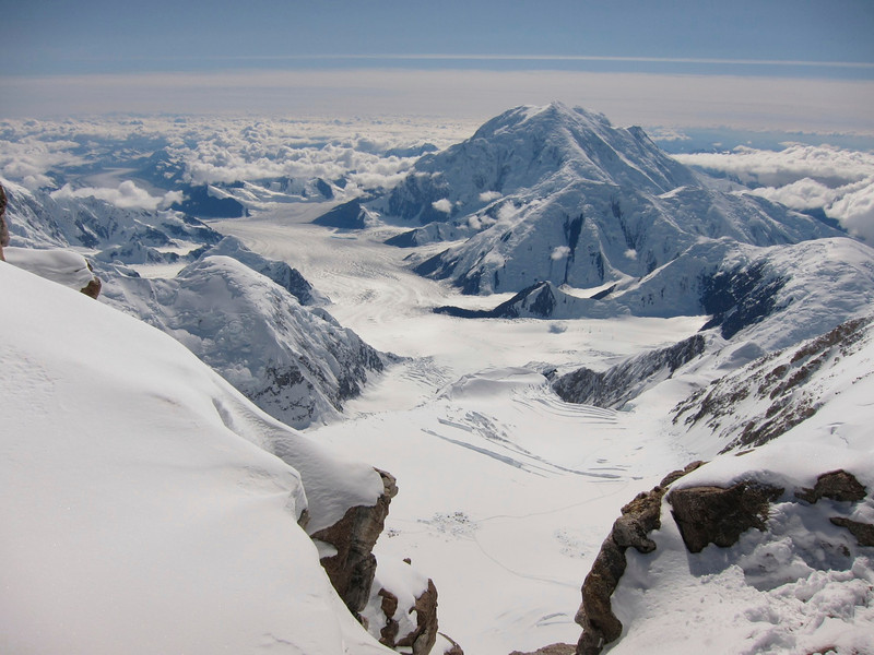 C3 (14,200ft = 4.328m) is visible below.  Kahiltna Glacier and Mt. Foraker (5.304m = 17,400ft) behind it.