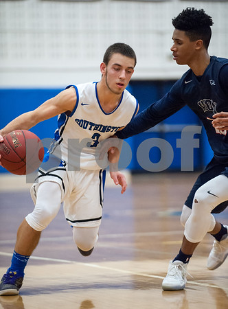 02/02/18 Wesley Bunnell | Staff Southington boys basketball was defeated 59-47 by Avon on Thursday night at Southington High School. Colin Burdette (3) drives.