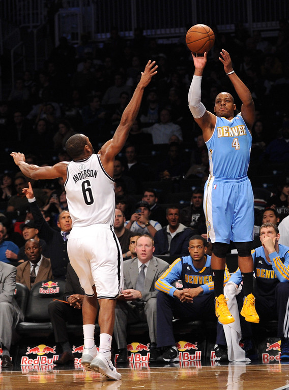 . NEW YORK, NY - DECEMBER 03:  Randy Foye #4 of the Denver Nuggets takes a shot over Alan Anderson #6 of the Brooklyn Nets during the first quarter at Barclays Center on December 3, 2013 in the Brooklyn borough of New York City.   (Photo by Maddie Meyer/Getty Images)