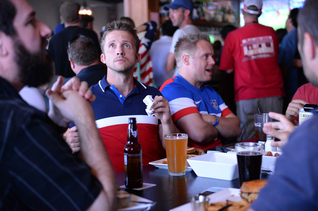 . Scott Sirowy, 30, left, of Redlands, and John Doolittle, 32, of Colton, watch the USA vs Belgium world cup game during a viewing party on Tuesday, July 1, 2014 at Darby\'s American Cantina in Redlands, Ca. (Photo by Micah Escamilla/The Sun)
