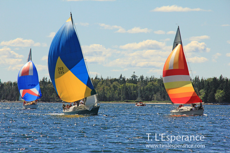 Spinnakers flying to cross the finish in French Village, Nova Scotia.