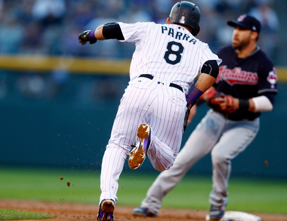 . Colorado Rockies\' Gerardo Parra, front, grabs his right thigh as he tries to steal second base as Cleveland Indians second baseman Jason Kipnis waits for the throw to put out Parra to end the third inning of an interleague baseball game Tuesday, June 6, 2017, in Denver. Parra was forced to leave the game after the inning-ending injury. (AP Photo/David Zalubowski)
