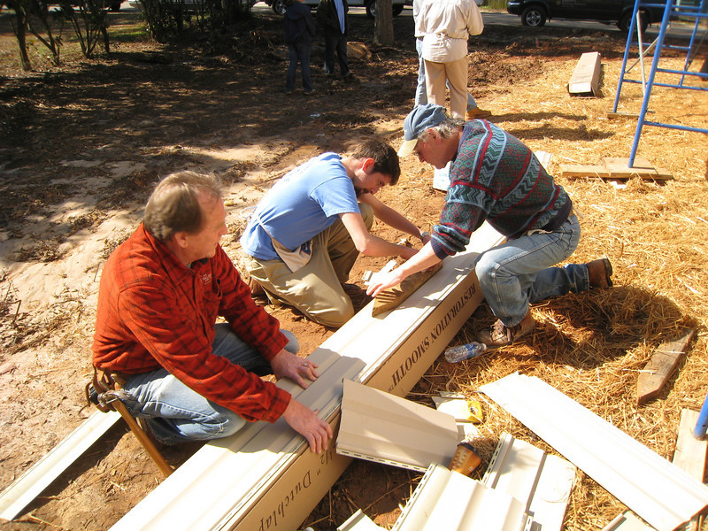 10 02-03  David Snell, Richard Aguirre and  Don Bauer are Fuller Center staff honoring Millard by building for two men in need of a decent place to live. ff