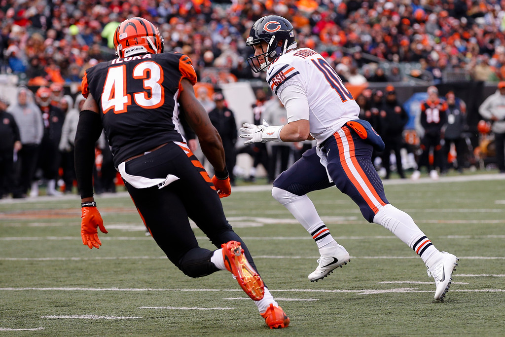 . Chicago Bears quarterback Mitchell Trubisky (10) runs in for a touchdown against Cincinnati Bengals free safety George Iloka (43) in the second half of an NFL football game, Sunday, Dec. 10, 2017, in Cincinnati. (AP Photo/Gary Landers)