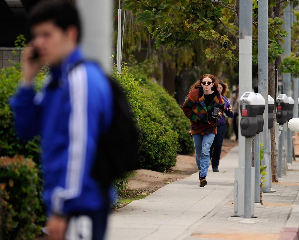 . SANTA MONICA, CA - JUNE 07:  Students rush to safety after shots were fired near the Santa Monica College on June 7, 2013 in Santa Monica, California. According to reports, at least three people have been injured, and a suspect was taken into custody. (Photo by Kevork Djansezian/Getty Images)