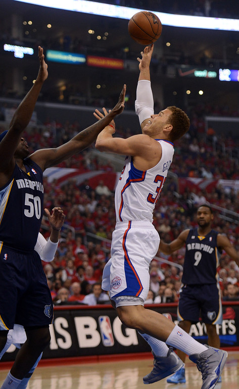. The Clippers\' Blake Griffin #32 shoots as the Grizzlies\' Zach Randolph #50 defends during their first round Western Conference Playoff game at the Staples Center in Los Angeles Saturday, April 20, 2013. (Hans Gutknecht/Staff Photographer)