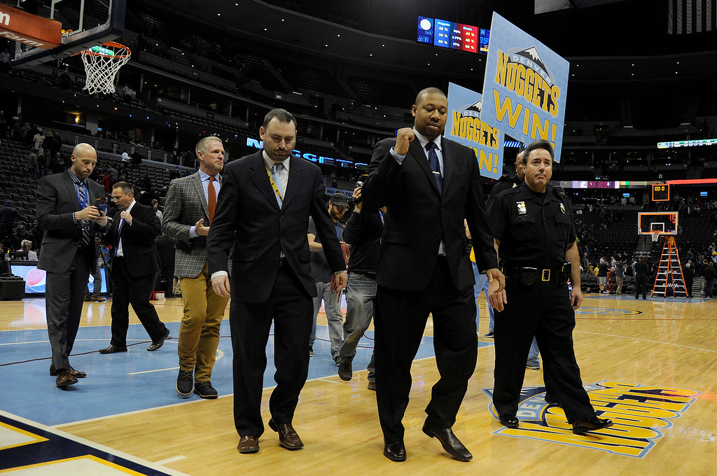 . DENVER, CO - MARCH 03: Interim head coach Melvin Hunt of the Denver Nuggets pumps his fist after securing win number one after the second half of a 106-95 Nuggets win over the Milwaukee Bucks. The Denver Nuggets hosted the Milwaukee Bucks at the Pepsi Center on Tuesday, March 3, 2015. (Photo by AAron Ontiveroz/The Denver Post)