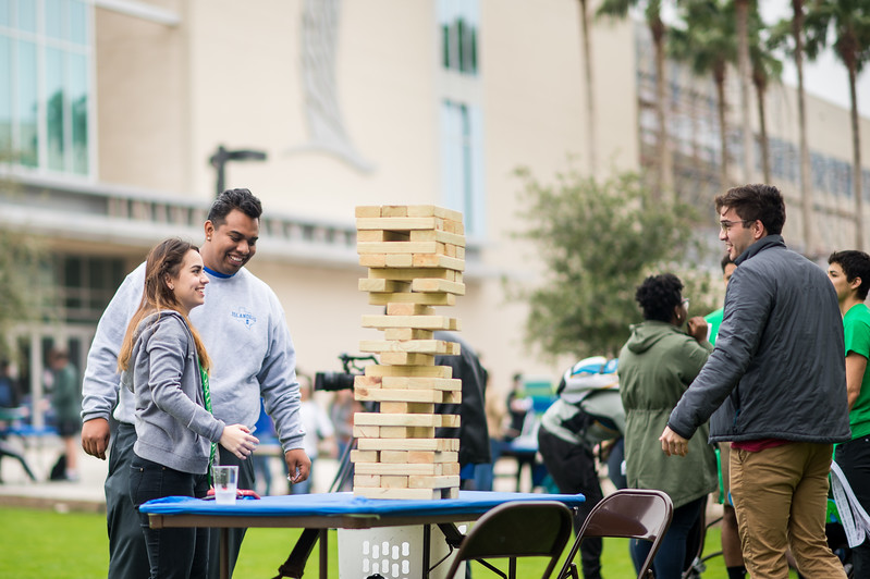 Sofia Rodriguez (left), Alan Contreras, and Terrin Vogel play a round of Jenga, during the Homecoming Tip-Off Picnic on the East Lawn.  Click on the link for more information on upcoming Homecoming events: http://bit.ly/18fYq5V