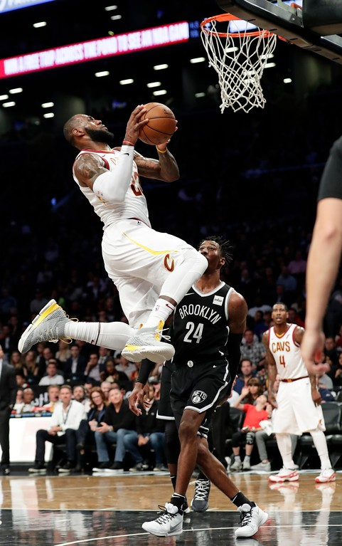 . Cleveland Cavaliers\' LeBron James drives past Brooklyn Nets\' Rondae Hollis-Jefferson (24) during the first half of an NBA basketball game Wednesday, Oct. 25, 2017, in New York. (AP Photo/Frank Franklin II)