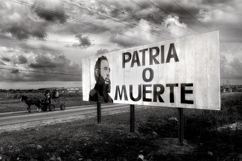 Country or death. A billboard on the road out of Trinidad keeps the revolutionary spirit alive.   Trinidad, Cuba, 2006.