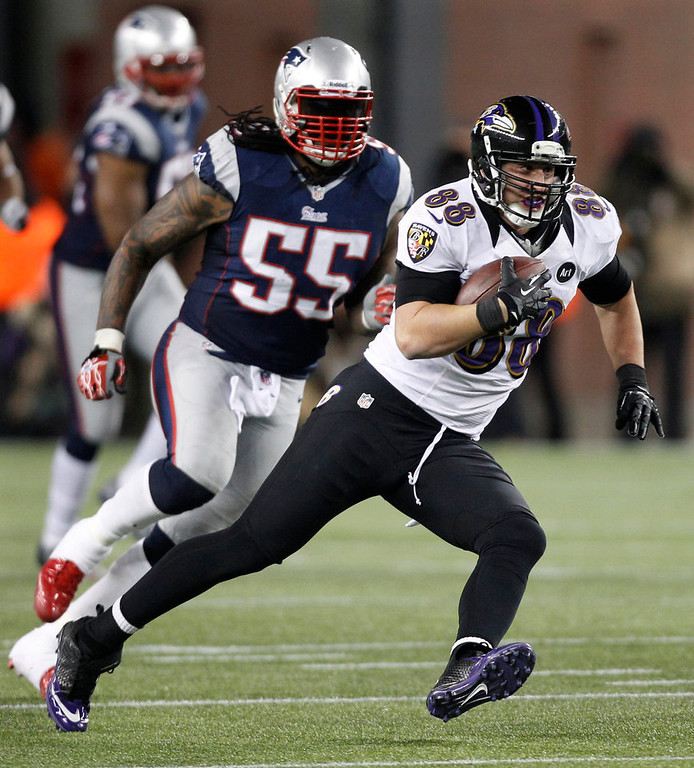 . Baltimore Ravens tight end Dennis Pitta (88) is chased by New England Patriots middle linebacker Brandon Spikes following a reception during the second half of the NFL football AFC Championship football game in Foxborough, Mass., Sunday, Jan. 20, 2013. (AP Photo/Stephan Savoia)
