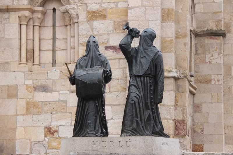 Black clad sculptures commemorating Zamora's Semanta Santa.