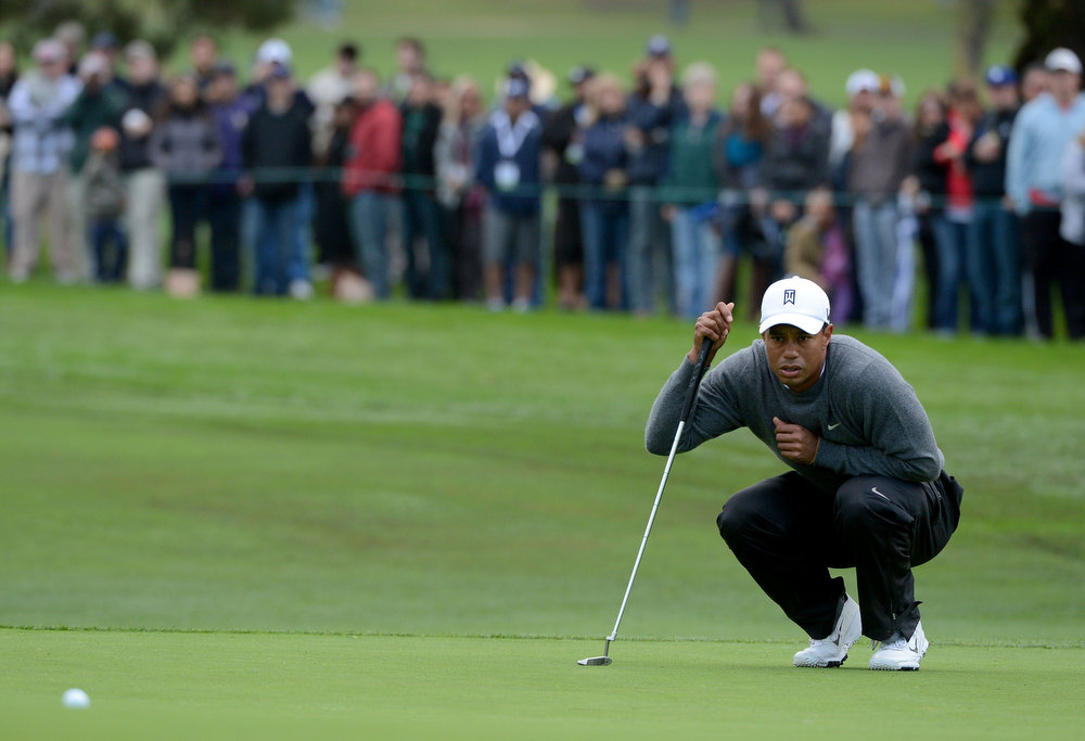 Description of . Tiger Woods studies the green during the Third Round at the Farmers Insurance Open at Torrey Pines South Golf Course on January 27, 2013 in La Jolla, California. (Photo by Donald Miralle/Getty Images)