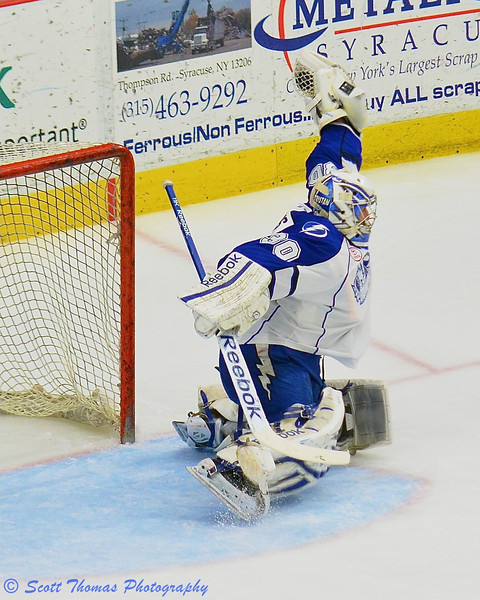 Syracuse Crunch goalie Cedrick Desjardins (30) snags a shot by a Grand Rapids Griffins player in American Hockey League (AHL) Calder Cup Finals Playoff action at the Onondaga County War Memorial on Saturday, June 8, 2013.