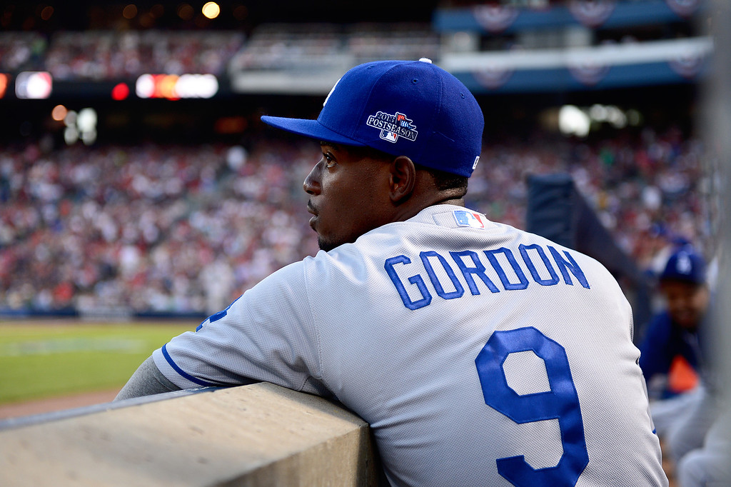 . Los Angeles Dodgers\' Dee Gordon keeps his eye on  game 2 of the playoffs Thursday, October 4, 2013 at Turner Field in Atlanta, Georgia. Braves defeated the Dodger 4-3. (Photo by Sarah Reingewirtz/Pasadena Star- News)