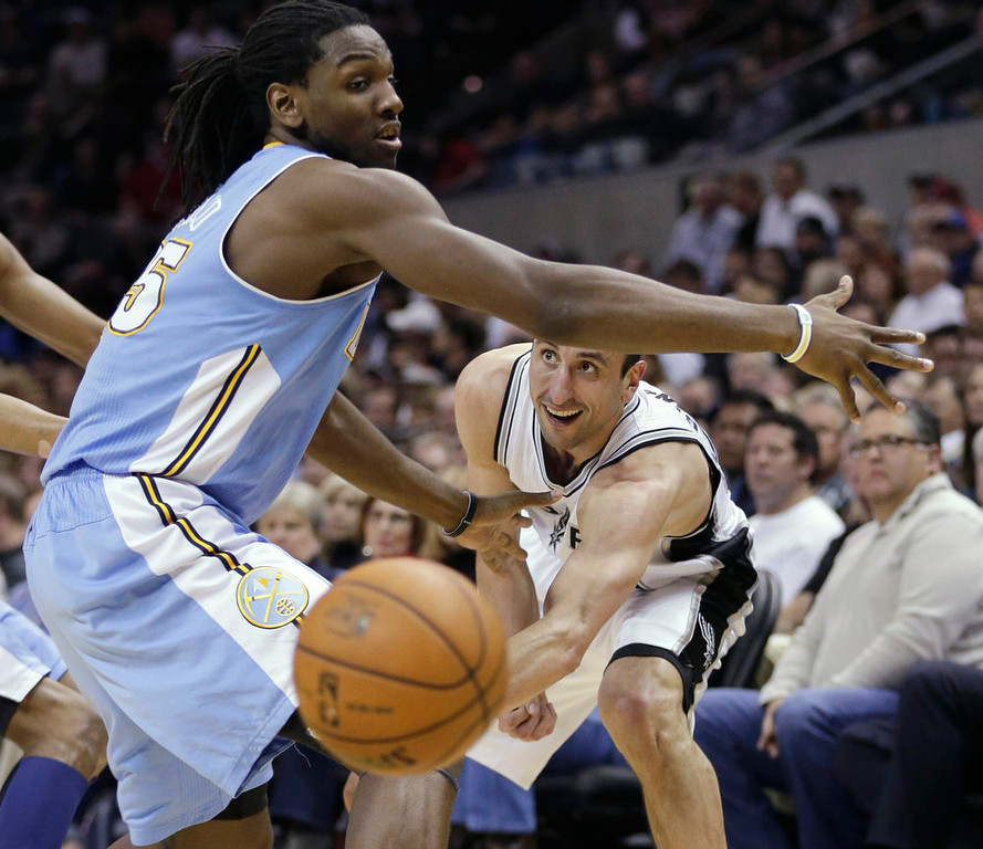. San Antonio Spurs\' Manu Ginobili, right, of Argentina, passes the ball under the arm of Denver Nuggets\' Kenneth Faried, left, during the first half of an NBA basketball game, Wednesday, March 27, 2013, in San Antonio. (AP Photo/Eric Gay)