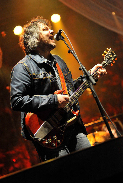 ". Wilco frontman Jeff Tweedy sings ""The Boys Are Back In Town\"" when opening an all covers set Friday at the 2013 Solid Sound Festival at MASS MoCA in North Adams, Mass. The evening\'s highlights included The Beatles\' \""And Your Bird Can Sing\"" and Dylan\'s \""Simple Twist of Fate.\"" (Peter Crabtree/Bennington Banner)"