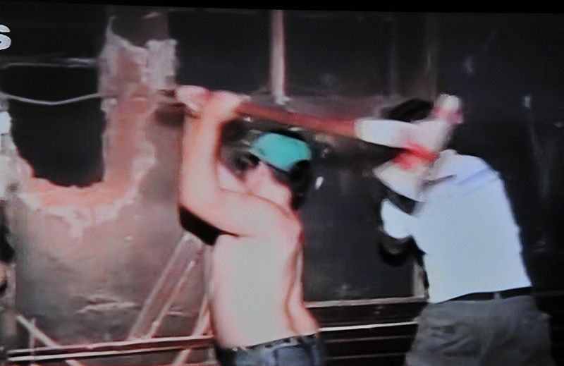. This frame grab taken from Brazil´s Globo News shows volunteers attempting to open an escape way at a night club while a fire raged inside in Santa Maria, 550 Km from Porto Alegre, southern Brazil on January 27, 2013. At least 232 people died and 131 were injured early Sunday when a fire tore through a nightclub packed with university students in the southern Brazilian city of Santa Maria, police said.    AFP  PHOTO/Globo News/BRAZIL OUTSTR/AFP/Getty Images
