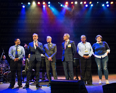 Outstanding Voices recipient Clayton Lewis (second from left), co-founder and CEO of Arivale, speaks as other Outstanding Voices honorees listen during the Puget Sound Business Journal's The Business Of Pride at the Paramount Theatre in Seattle on Thursday, May 26, 2016. (BUSINESS JOURNAL PHOTO | Dan DeLong)