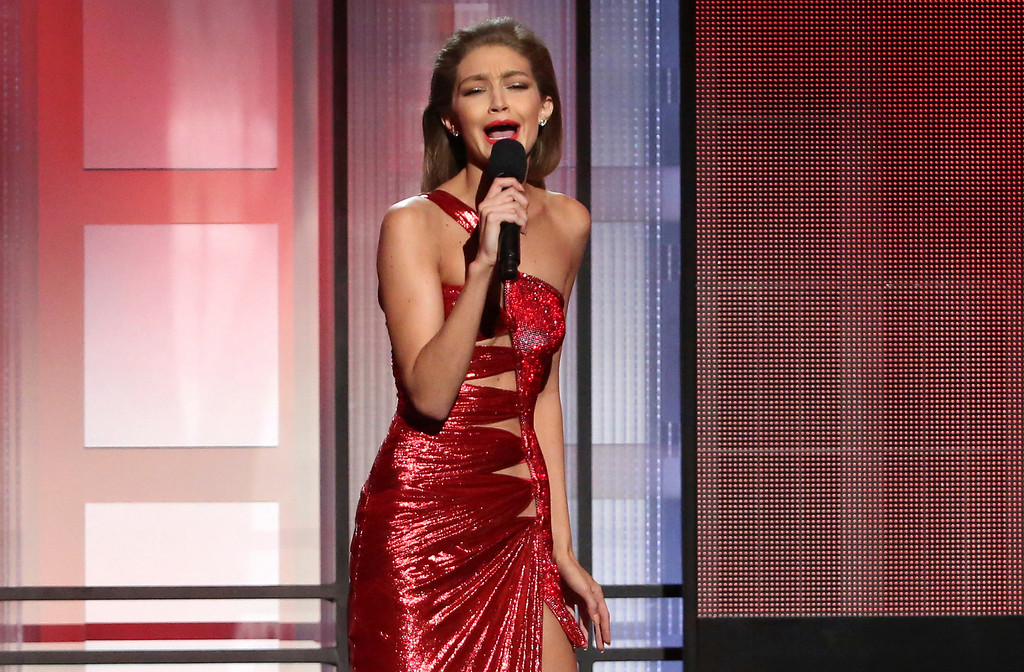 . Host Gigi Hadid impersonates Melania Trump at the American Music Awards at the Microsoft Theater on Sunday, Nov. 20, 2016, in Los Angeles. (Photo by Matt Sayles/Invision/AP)