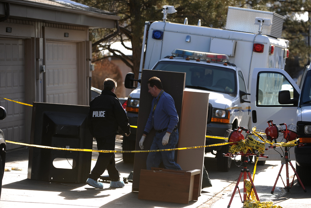 Description of . Aurora police and investigators look through the contents of the garage of the shooter as they continue to process the scene of the shootings at 16005 Ithaca place in Aurora today January 6th, 2013.    In what police officers called