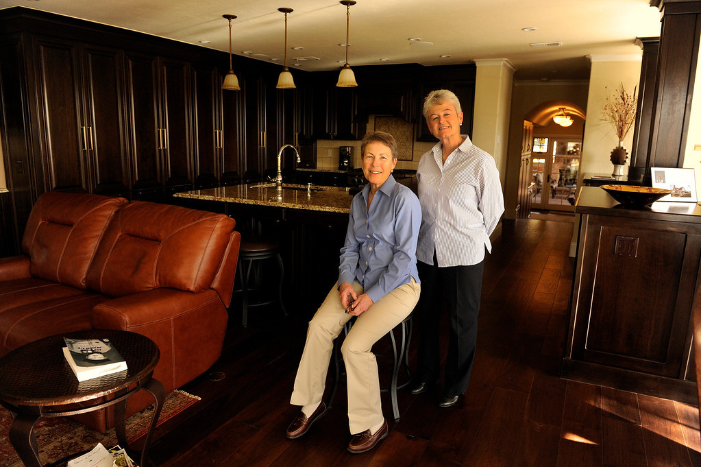 ". DENVER, CO - NOVEMBER 13: Jeannine Spicer, left, and June Eshelman, right, pose for a portrait inside their renovated home on November 13, 2013, in Denver, Colorado. Spicer\'s parents purchased the house in 1964 and continued to live there until her mother\'s passing in 2010. During that time, the house underwent few renovations. When Spicer inherited the property, she decided to fully demolish the interior, while still preserving the historic and architectural characteristics of the 1936 Tudor building. For their efforts, Spicer and Eshelman won a 2013 Mayor\'s Design Award in the ""It Just Fits\"" category. (Photo by Anya Semenoff/YourHub)"