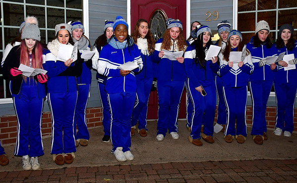 12/7/2018 Mike Orazzi | Staff Southington High Cheerleaders sing carols during White Christmas in the Community in downtown Southington Friday evening.