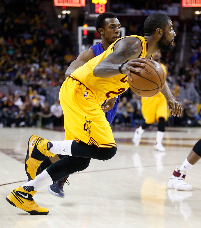 . Cleveland Cavaliers\' Kyrie Irving (2) drives past Detroit Pistons\' Ish Smith (14) during the second half of an NBA basketball game Friday, Nov. 18, 2016, in Cleveland. (AP Photo/Ron Schwane)