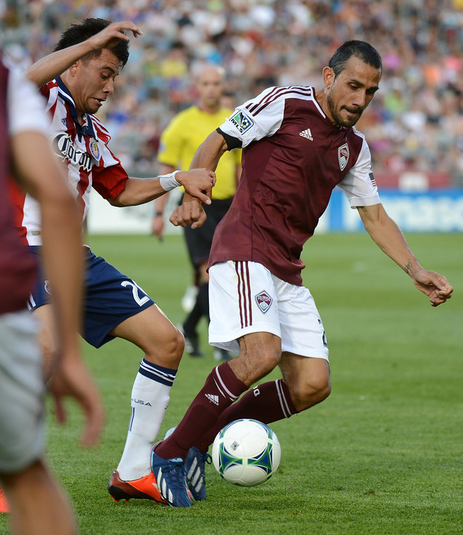 . Pablo Mastroeni of Colorado Rapids (25) controls the ball against Carlos Alvarez of Chivas USA (20) in the 1st half of the game at Dick\'s Sporting Goods Park. Commerce City, Colorado. May 25, 2013. (Photo By Hyoung Chang/The Denver Post)