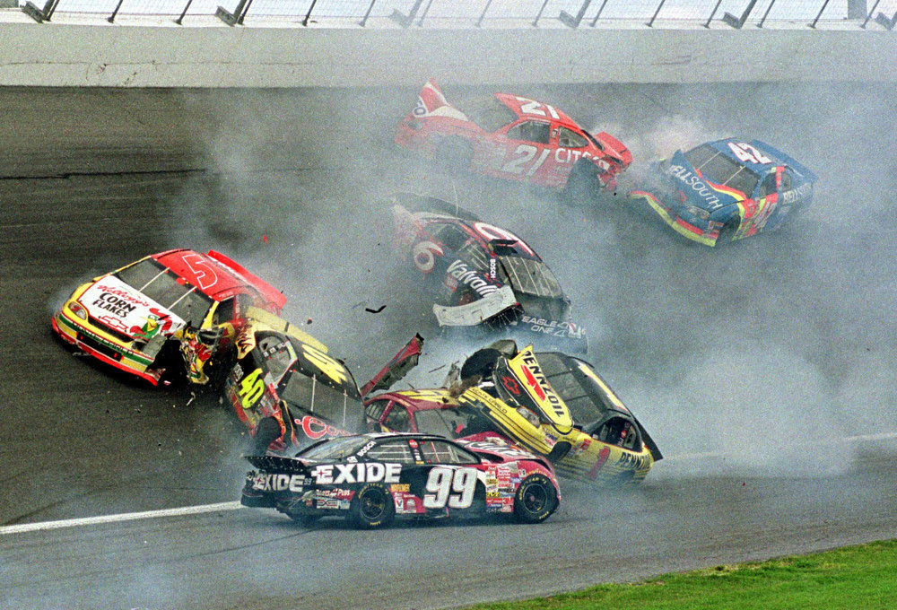 Description of . Drivers Jeff Burton, of South Boston, Va., (99), Steve Park, of East Northport, N.Y., (1), Sterling Marlin, of Columbia, Tenn., (40), Terry Labonte, of Corpus Christi, Tex., (5), Mark Martin, of Batesville, Ark., (6), Elliott Sadler, of Emporia, Va., (21) and Joe Nemechek, of Lakeland, Fla. (42) are involved in a crash during the Daytona 500 Sunday, Feb. 14, 1999, at the Daytona international Speedway in Daytona Beach, Fla. Driver Jeff Gordon won the race Sunday. (AP Photo/Paul Kizzle)