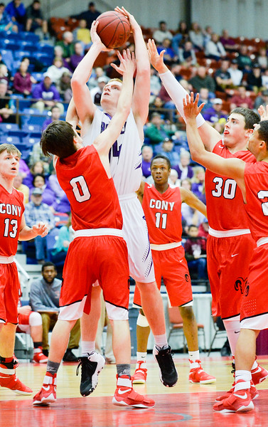 Cony's Austin Parlin gets in the face of Hampden's Ian McIntyre as he surrounded by Cony defenders in the first half of the Class A North Quarterfinal Saturday in Augusta. McIntyre made the two-point shot.