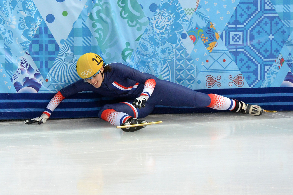 . France\'s Veronique Pierron falls as she competes the Women\'s Short Track 500 m Heats at the Iceberg Skating Palace during the Sochi Winter Olympics on February 10, 2014.  DAMIEN MEYER/AFP/Getty Images