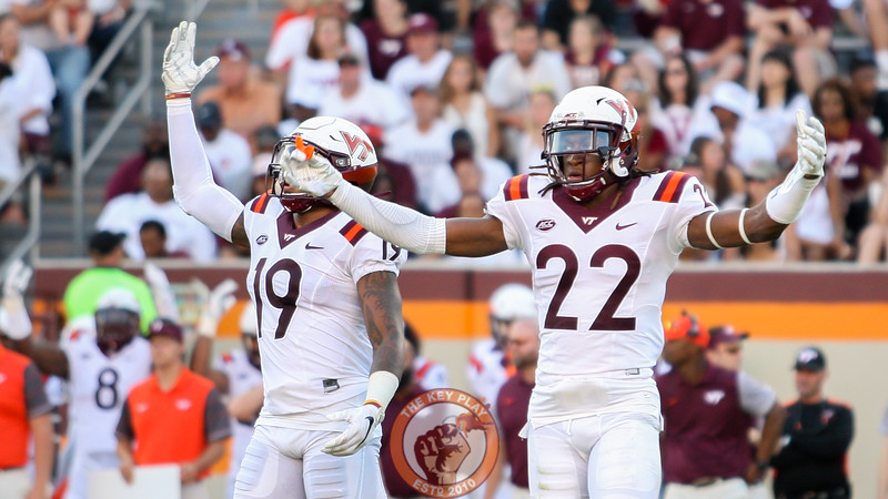 Defensive backs Chuck Clark (19) and Terrell Edmunds (22) pump up the crowd when the Hokies enter back on defense in the third quarter. (Mark Umansky/TheKeyPlay.com)