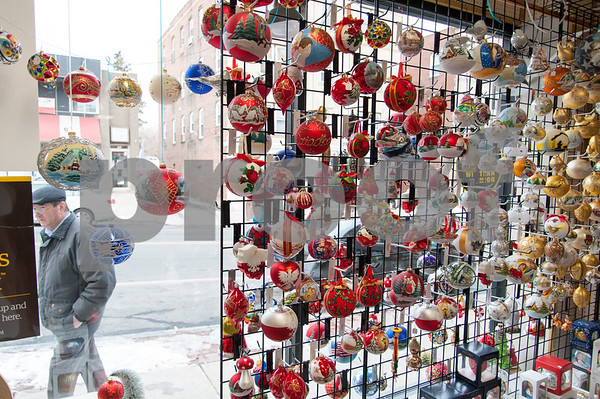 12/18/17 Wesley Bunnell | Staff Christmas decorations in the front window of Quo Vadis gift shop on Broad Street are shown on Monday afternoon.