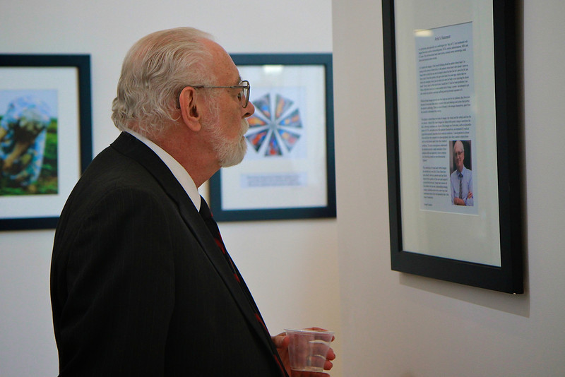 Joseph Gascho, cardiologist from Penn State Hershey Medical Center, hosts an art and poetry show in the Tucker Student Center; January 2013.