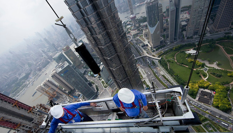 Window cleaners above Shanghai's Financial District, 2011