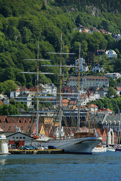 The tall ship Statsraad LehmKuhl sits at the waterfront in Bergen.