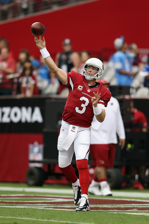 . Quarterback Carson Palmer #3 of the Arizona Cardinals drops back to pass prior to the start of the game against the Detroit Lions at University of Phoenix Stadium on September 15, 2013 in Glendale, Arizona.  (Photo by Jeff Gross/Getty Images)
